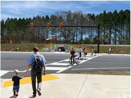Crosswalks and a walkway underneath the train tracks are one proposed way to increase pedestrian safety. This rendering includes on the HWY 123 Corridor's bigger recommendations at the intersection near Harts Cove and Epoch Clemson, two large student apartment complexes.