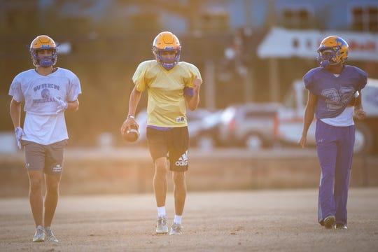 Joe Owens, center, Wren High School quarterback, during practice Monday, November 25, 2019.