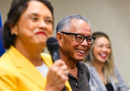 Frank Ishizaki, center, sports a smile as Gov. Lou Leon Guerrero shares a lighthearted remark about their familial relationhship during a press conference at Adelup on Tuesday, Nov. 26, 2019. During the conference, Ishizaki, who has served as a former Guam lawmaker, a retired FBI agent, and former Guam chief of police, it was annouced that he had accepted the appointment by Gov. Leon Guerrero to serve as the Guam Department of Corrections acting director. This will be Ishizaki's second time serving at the helm of the prison facility.