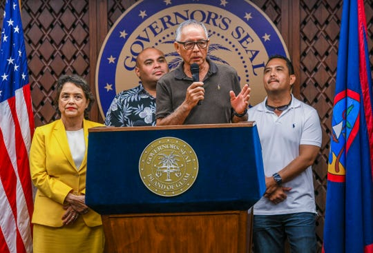 Frank Ishizaki, center, speaks during a press conference at Adelup on Tuesday, Nov. 26, 2019. During the conference, Ishizaki, who has served as a former Guam lawmaker, a retired FBI agent, and former Guam chief of police, it was announced that Ishizaki had accepted the appointment by Gov. Leon Guerrero, left, to serve as the Guam Department of Corrections acting director. This will be Ishizaki's second time serving at the helm of the prison facility.