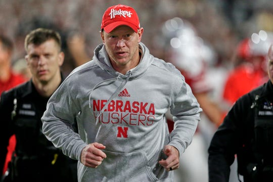 Scott Frost, shown exiting Memorial Stadium after a 48-7 loss to Ohio State, brings a 9-14 coaching mark with Nebraska into Friday's contest against Iowa.
