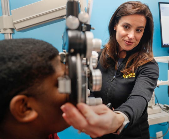 Dr. Katherine Schuetz performs an eye examine on David Young at Little Eyes in Carmel.
