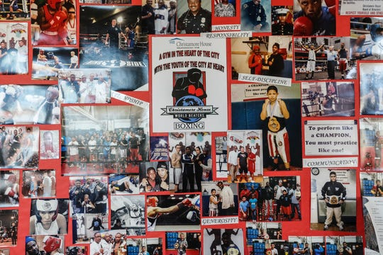 Photos of participants in the Christamore House boxing program hang in a hallway at the center in Indianapolis on Monday, Nov. 25, 2019.
