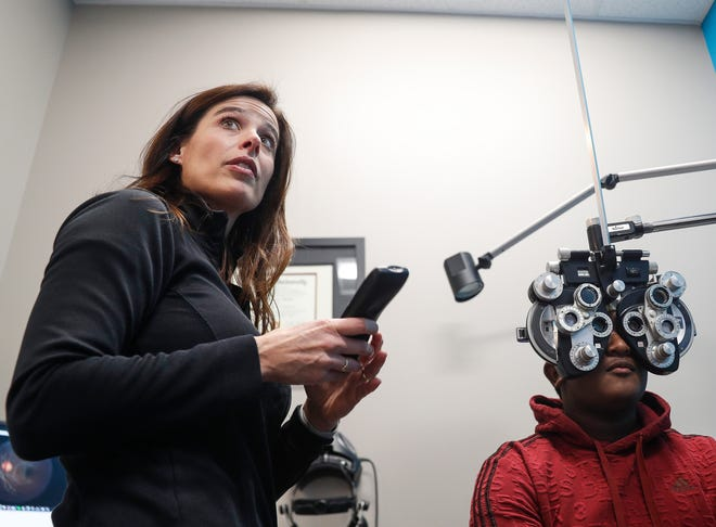Dr. Katherine Schuetz preforms an eye examine on David Young at Little Eyes on South Rangeline Rd, Carmel, Ind., Saturday, Nov. 23, 2019.