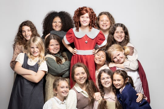 """Promotional photos for Courtesy of City Circle Acting Company's 2019 production of """"Annie."""" Pictured is Camila Koch as Annie surrounded by her fellow orphans played by McKenzie Vedepo, Shea Sanders, Chelsea Vedepo, Maya Hanna, Ana Rippentrop, Clara Visser, Maple Miller, Grace Bartlett, Rana Saba, Maddie Mitchell, Violet Whiting and Lily Vogts."""