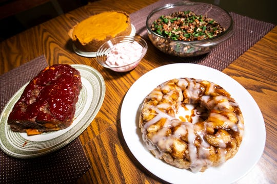 Boo's Meatloaf, Pink Stuff, chiffon pie, and wild rice pilaf and cinnamon pull apart bread are pictured, Sunday, Nov. 24, 2019, in Iowa City, Iowa.