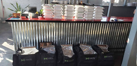 Boxes of meals are stacked up before shipping out of Baker Brothers BBQ on Monday for free meals for Thanksgiving delivered by Waitr.