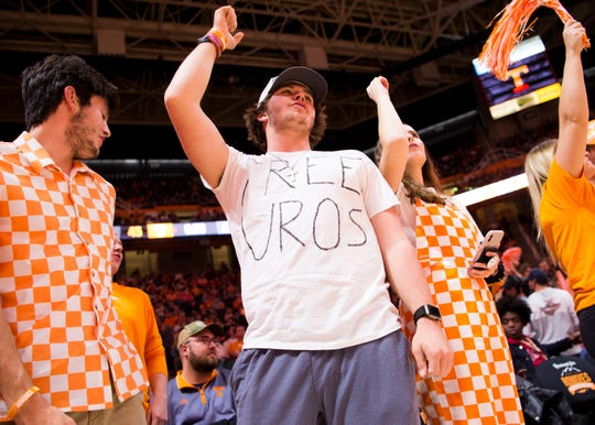 """A student wears a """"Free Uros"""" shirt during Tennessee's game against Chattanooga on Monday."""