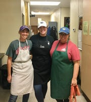 Kaitlin Davis, left, and her roommates, Jenna Landry, middle, and Annie Ducote, volunteer at St. Joseph's Diner.