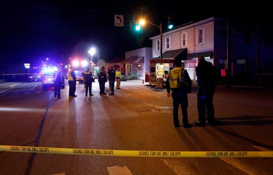 Lancaster police officers investigate a crash involving an Amanda Township Fire Department ambulance and Nissan Altima Tuesday evening, Nov. 26, 2019, at the intersection of Maple and East Main streets in Lancaster.