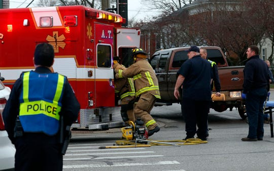 Firefighters force open the back doors of an Amanda Township Fire Department ambulance Tuesday evening, Nov. 26, 2019, at the intersection of East Main and Maple streets in Lancaster. The ambulance and a Nissan Altima collided in the instersection. The ambulance was taking a patient to Fairfield Medical Center when the crash happened. Four Amanda Township firefighters in the ambulance and their patient were taken to FMC by Hocking Township ambulances. The driver of the car that was hit was flown to Grant Medical Center in Columbus.