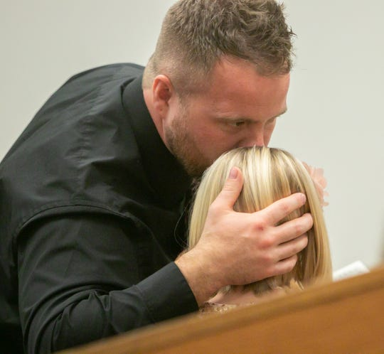 Brian Crandall gives just adopted daughter, Addilyn Crandall, 7, a kiss during Adoption Day Tuesday, Nov. 26, 2019.