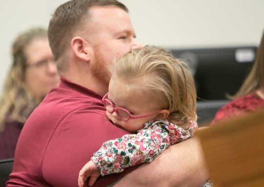 Jeff Poag holds Eliana, 1, who would shortly become his adopted daughter Tuesday, Nov. 26, 2019 during Adoption Day in Judge Miriam Cavanaugh's courtroom.