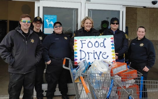 Members of the Livingston County Sheriff's Office collected food at the Walmart in Howell Saturday Nov. 23, 2019.