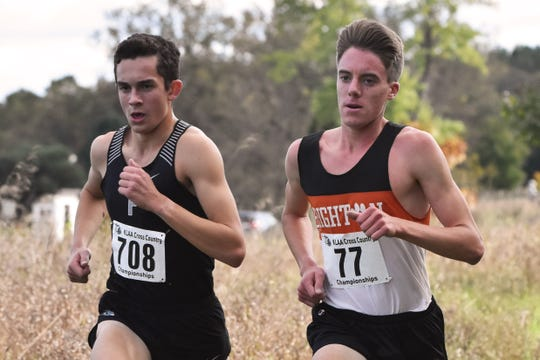 Brighton's Jack Spamer (77) runs with eventual state champion Carter Solomon of Plymouth in the KLAA cross country meet.