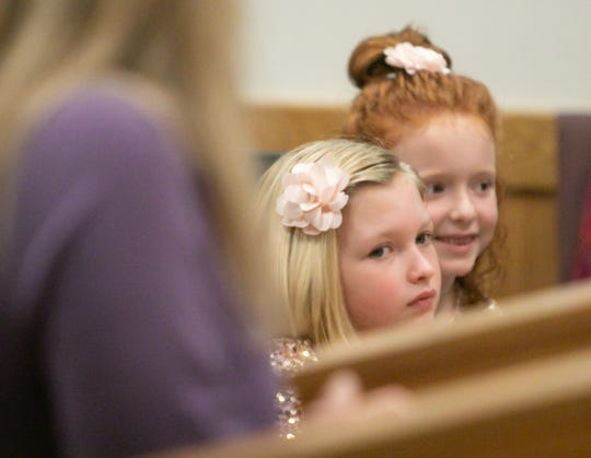 Seven-year-old Addilyn Crandall and soon-to-be-adopted sister, Emery, listen as Addilyn is adopted by Brian and Jackie Crandall Tuesday, Nov. 26, 2019 in Judge Miriam Cavanaugh's courtroom.