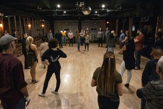 Dancers of various skill levels gather on the club floor at Hotel Louisville for a salsa dancing lesson from local instructor Chelsey Owen.