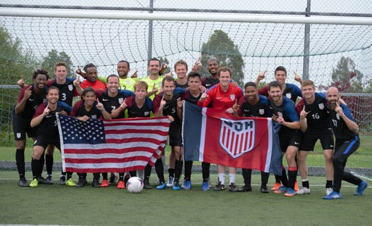 Louisville native Will Frentz (#5, middle) celebrates USA Deaf Soccer's Pan-American championship earlier this month.