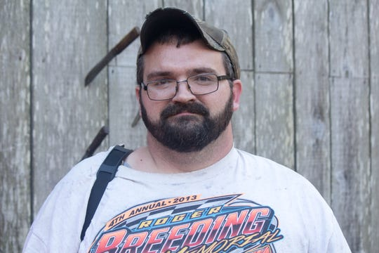 Adam Smith lives in Defeated Creek, a holler in rural Letcher County. He pays $170 a month for satellite TV and internet. He wishes there were more options.