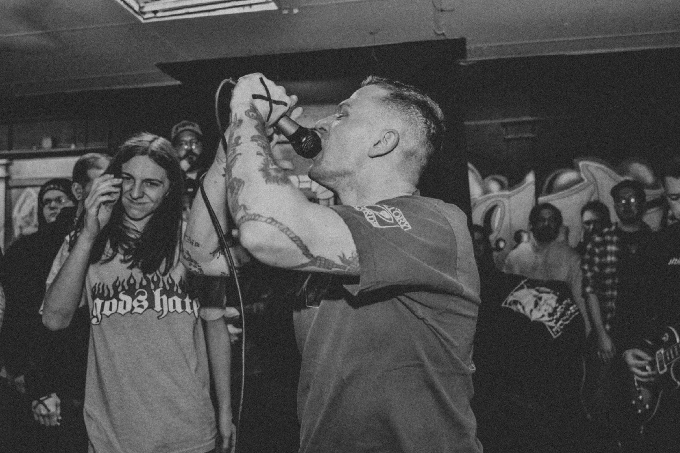 Tyler Short perfoms vocals for his straight edge hardcore band, Inclination, in 2018.