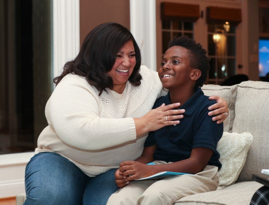 Deedee Cummings, left, shares a laugh with her son Nick Cummings, 11, at their home in Louisville.