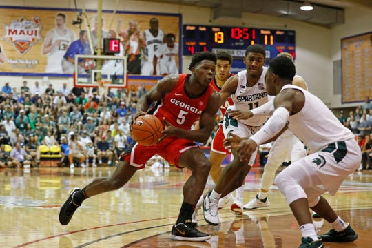 Georgia guard Anthony Edwards (5) drives into the Michigan State defense during the first half of an NCAA college basketball game Tuesday, Nov. 26, 2019, in Lahaina, Hawaii. (AP Photo/Marco Garcia)