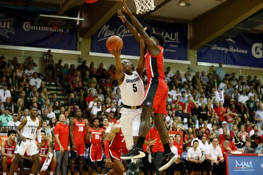 Georgia guard Anthony Edwards, right, blocks a shot from Michigan State guard Cassius Winston (5) during the first half of an NCAA college basketball game Tuesday, Nov. 26, 2019, in Lahaina, Hawaii. (AP Photo/Marco Garcia)