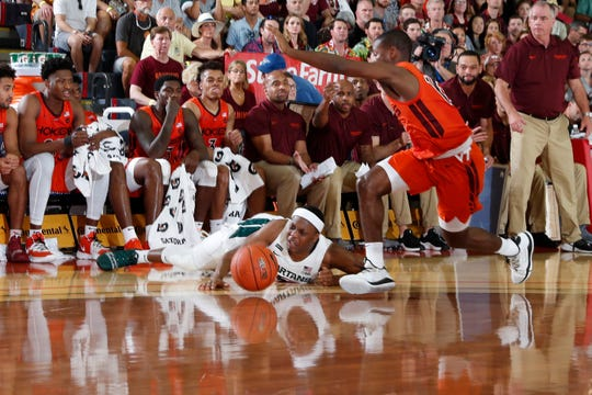 Nov 25, 2019; Lahaina, HI, USA; Michigan State Spartans guard Cassius Winston (5) slips on the floor as he drives to the basket against the Virginia Tech Hokies during the first half of the first day of the Maui Jim Maui Invitational at the Lahaina Civic Center. Mandatory Credit: Brian Spurlock-USA TODAY Sports