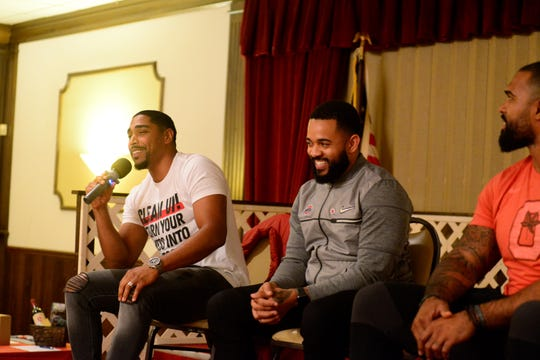 """Former Buckeye football players Antonio Smith, along with Dan """"Boom"""" Herron (right), were among the featured speakers for Monday's Buckeye Bash."""
