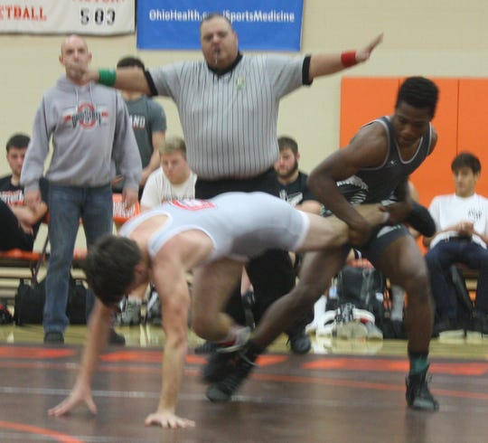 Crestview's Levi Kibler tries to escape the grip of Madison's Jamaal Coleman in Monday's NCOWOA All-Star Preview Wrestling Meet at Mansfield Senior. Kibler went on to a 5-0 victory.