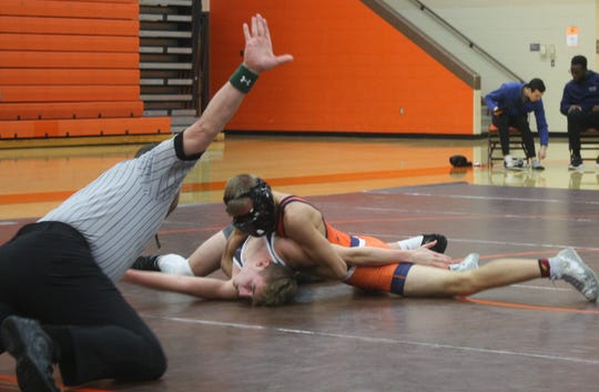 Galion's Devin McCarthy, wearing a facemask to protect a broken nose, had one of the three pins in Monday's NCOWOA All-Star Wrestling Preview at Mansfield Senior