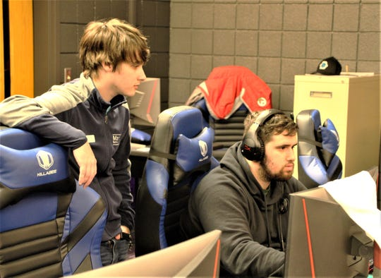 Marion Technical College Esports coach Drew Brown, left, watches as Gabriel Sayre plays a game in the college's Esports Arena, located in Bryson Hall room 141. Brown is a semi-professional Overwatch player who began his tenure as coach at MTC in September. Sayre, 21, is a sophomore studying robotics and automation engineering at MTC.