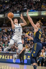 Memphis Grizzlies guard Grayson Allen (3) shoots the ball while Indiana Pacers forward Domantas Sabonis (11) defends in the second half at Bankers Life Fieldhouse in Indianapolis on Nov 25, 2019.