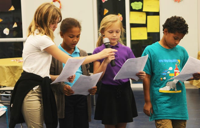 After school students present a reading about the significance of Thanksgiving.