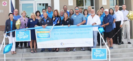 Cutting the ribbon makes the Blue Zones designation official.