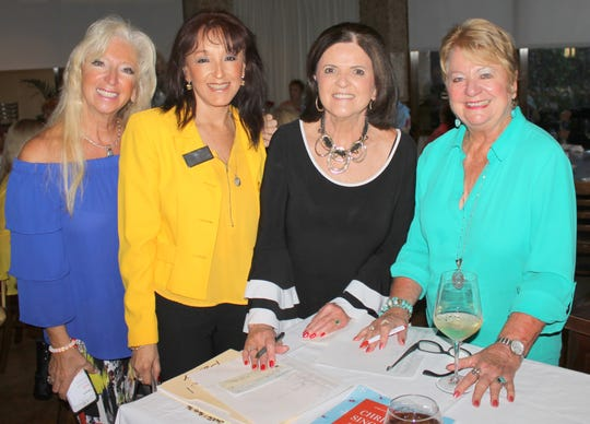 President Rose Kraemer help Laverne Leahy and Pat Hagedorn welcome Angelica Andrews.