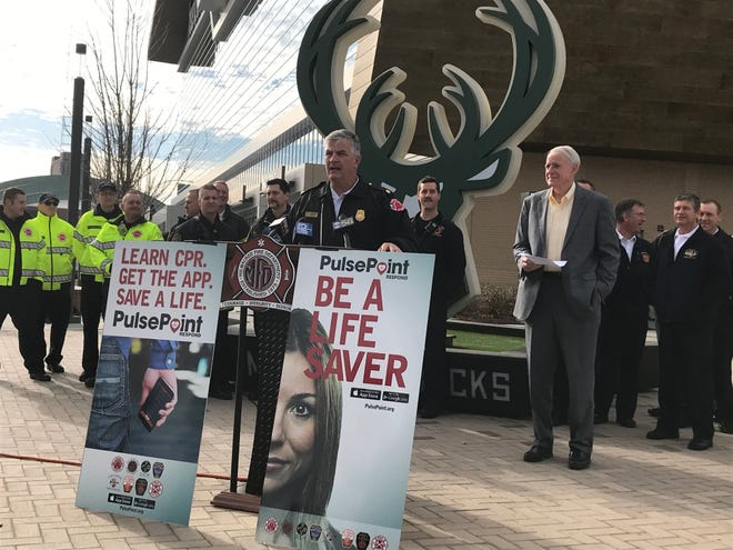 Milwaukee Fire Department Chief Mark Rohlfing explains the PulsePoint app during a news conference Tuesday outside Fiserv Forum.