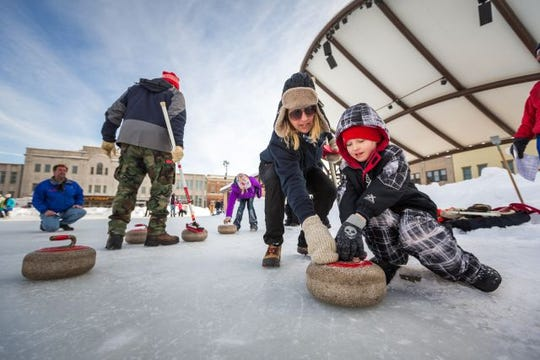 A family practices curling during Winterfest on Broadway, held on the streets of Wausau. This year the event takes place on January 25.