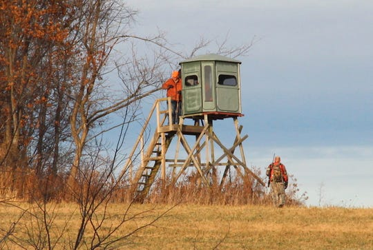 Hunters prepare for a deer hunt near a box blind on a farm near Alma, Wis.