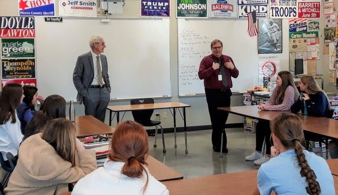 Prescott High School civics teacher Jeff Ryan, right, introduces Gov. Tony Evers to his students on Nov. 22.