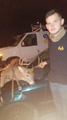 Peter Mehlbrech holds his eight-point buck that he shot on opening day. It went viral in a picture of it on a Honda Civic in front of Kwik Trip