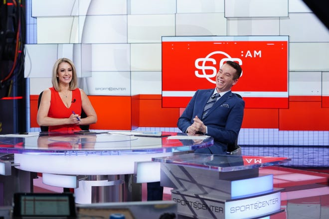 """Nicole Briscoe and co-anchor Randy Scott share a laugh on the set of """"SportsCenter."""""""