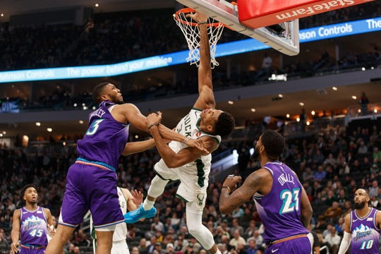 Bucks forward Giannis Antetokounmpo is fouled by Utah Jazz center Tony Bradley.