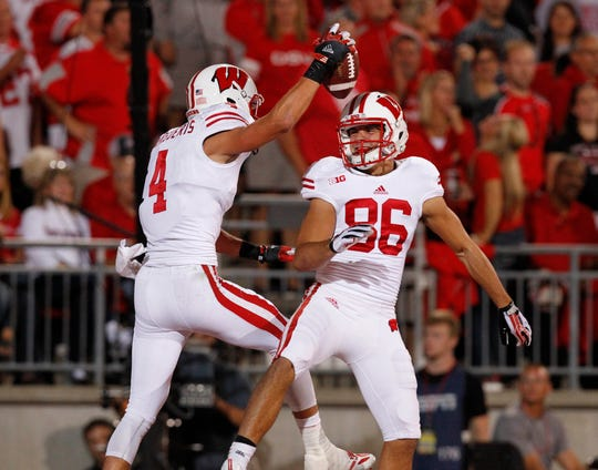 Wisconsin Badgers wide receiver Jared Abbrederis (4) reacts to his touchdown score with Wisconsin Badgers wide receiver Alex Erickson (86) during the Big Ten football game between the Wisconsin Badgers and the Ohio State Buckeyes at Ohio State, Saturday, September 28, 2013. Journal Sentinel photo by Rick Wood/RWOOD@JOURNALSENTINEL.COM