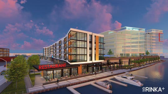An apartment building, with a ground-floor restaurant, will be built at the River 1 mixed-use development.