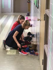 Student Council members at St. Sebastian school in Milwaukee help out St. Nick by filling students' shoes with treats.