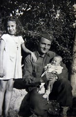 Conchita Cammerata, left, poses with Donald Gall, a 25-year-old Army soldier from Wisconsin serving in Sicily during World War II. Gall holds her baby sister, Alba, in this 1943 photo.
