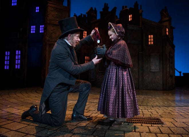 "Jonathan Wainwright returns for a fourth year as Scrooge in Milwaukee Repertory Theater's production of ""A Christmas Carol,"" which continues through Dec. 24.  In this photo from the 2017 production, Wainwright is seen with Olivia Vitrano."