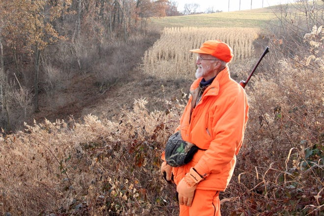 RIchard Noll of Waterford looks out over the rolling terrain while deer hunting Sunday near Alma. Noll is especially appreciative of this year's hunt with family because he was revived after suffering a heart attack on Aug. 10.