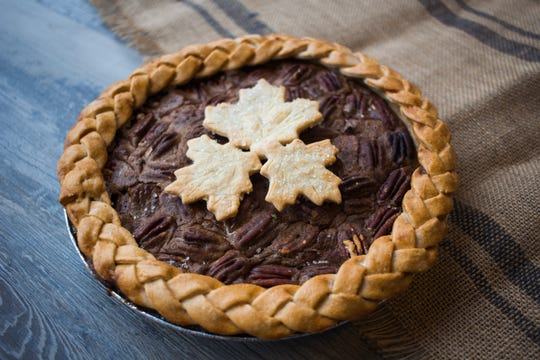 Pecan pie from Greige Patisserie gets a fall look with a braided-edge crust and pastry leaves.